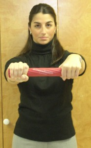 Figure 1: Arms brought in front of body with elbows in extension while maintaining twist in rubber bar by holding with noninvolved wrist in full flexion and the involved wrist in full extension.